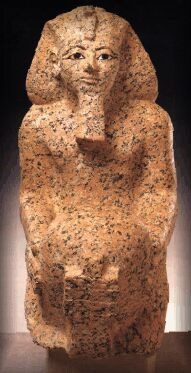 A red granite statuette of 'King' Hatshepsut